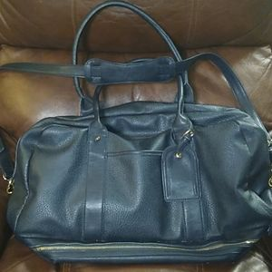 Navy duffle bag with 4 compartments